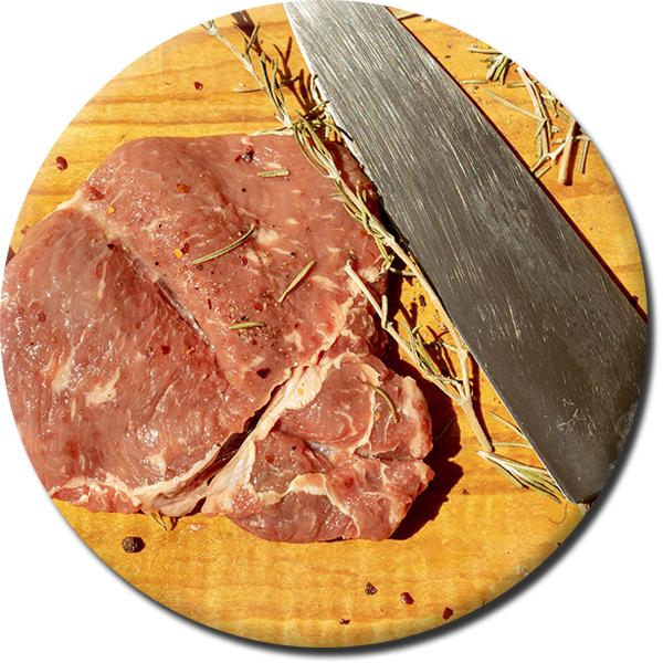 rundes Bild mit einem rohen Steak und einem Messer
