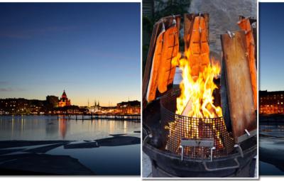 Panorama von Helsinki am Abend mit eingeblendeten Flammlachs im Feuerkorb