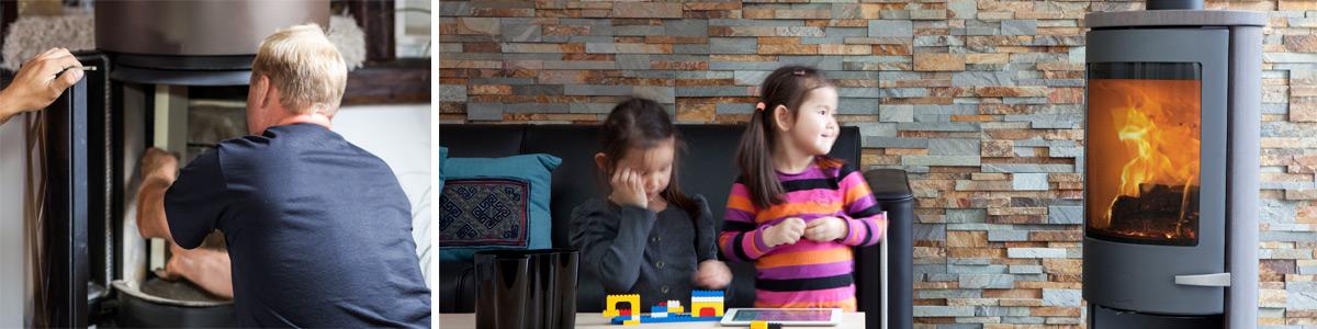 Monteure bei der Arbeit und mit Legosteinen spielende Kinder vor dem befeuerten Kamin